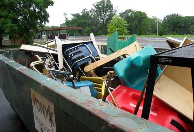 chairs in a skip dumpster.jpg