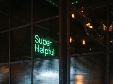 green Super helpful neon signage near window photo – Free Neon Image on Unsplash