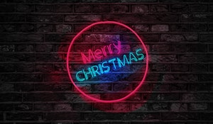 turned-on-red-and-blue-merry-christmas-neon-sign-754430-1
